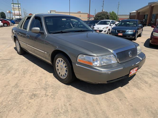 2004 green /tan Mercury Grand Marquis GS (2MEFM74W74X) with an 4.6L V8 OHC 16V engine, 4-Speed Automatic Overdrive transmission, located at 14700 Tomball Parkway 249, Houston, TX, 77086, (281) 444-2200, 29.928619, -95.504074 - Photo #0